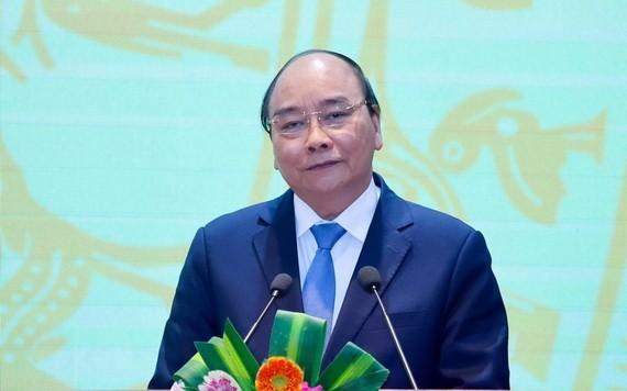 政府總理阮春福主持會議並發表講話。(圖源:越通社)