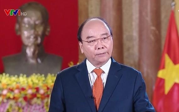 國家主席阮春福4月20日以視頻方式出席博鰲亞洲論壇並發表演講。(圖源:VTV)