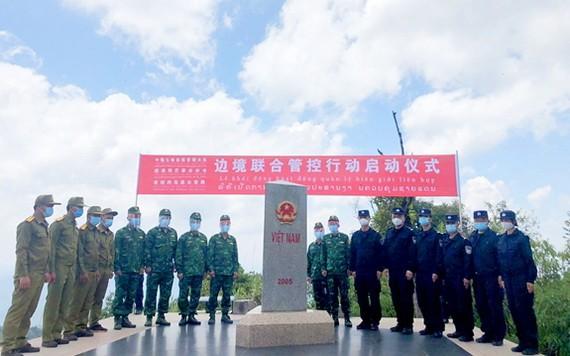 越南-中國-老撾3國的邊防保護力量22日在三國邊境交界處實地舉行會晤。(圖源:人民軍隊報)