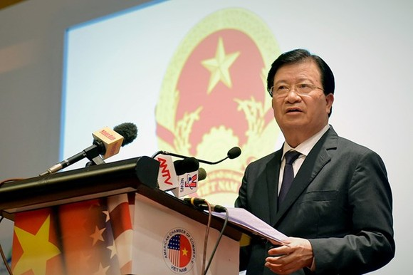Deputy Prime Minister Trinh Dinh Dung addresses the Vietnam-US business forum in Hanoi on May 10 (Photo: VNA)