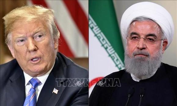 Tổng thống Mỹ Donald Trump (trái) và Tổng thống Iran Hassan Rouhani. Ảnh: AFP/TTXVN
