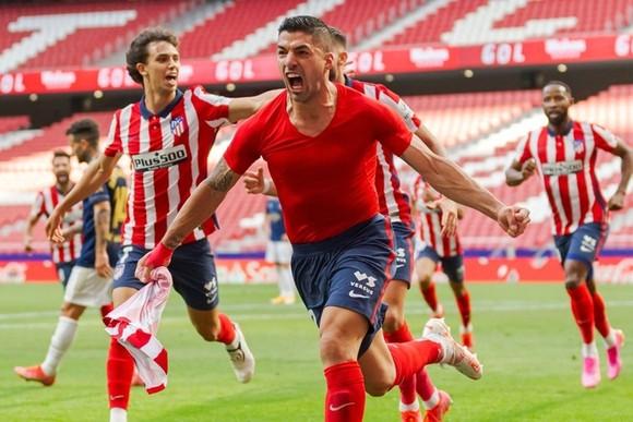 Luis Suarez tỏa sáng vào thời khắc hệ trọng nhất của Atletico Madrid. Ảnh: Getty Images