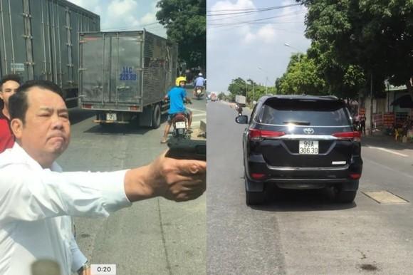 Bắt khẩn cấp giám đốc công ty bảo vệ rút súng dọa giết tài xế trên Quốc lộ 18 ảnh 1