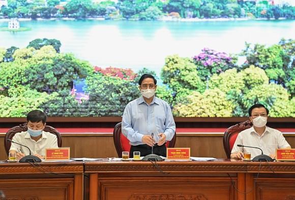 Làm việc với Thủ tướng, Hà Nội thể hiện quyết tâm kiểm soát được dịch Covid-19 ảnh 1