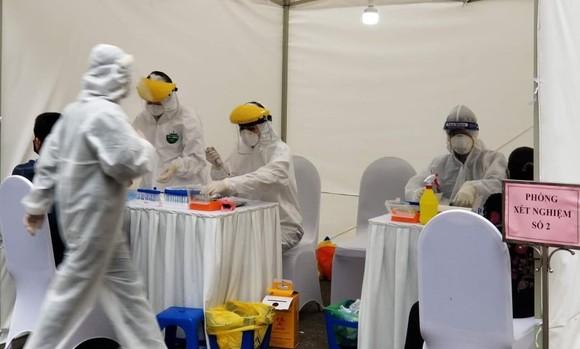 Sáng 27-7, Hà Nội phát hiện thêm 13 ca dương tính SARS-CoV-2 ở cộng đồng ảnh 1