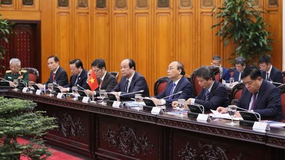 Thủ tướng Nhật Bản bắt đầu chuyến thăm chính thức Việt Nam ảnh 7