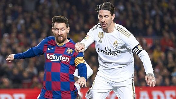 Sergio Ramos hy vọng Messi ở lại để giúp các trận Siêu kinh điển hấp dẫn hơn. Ảnh: Getty Images