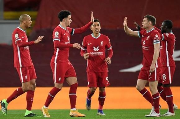 Liverpool quá mạnh để qua đó có đồng điểm với Tottenham ở ngôi đầu Premier League. Ảnh: Getty Images