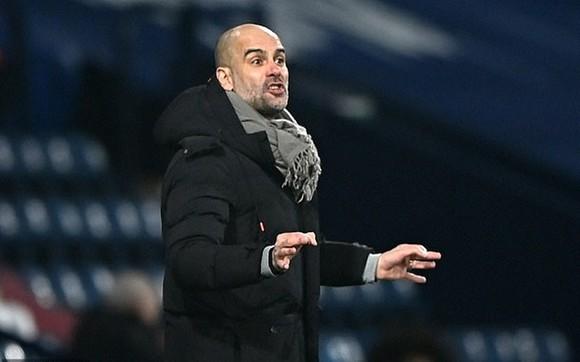 HLV Pep Guardiola vẫn đầy thận trọng khi bàn về triển vọng vô địch. Ảnh: Getty Images