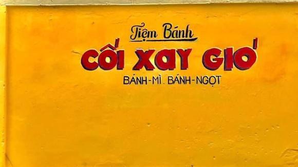 Bức tường màu vàng nổi tiếng của tiệm bánh Cối xay gió từng là điểm check -in của nhiều bạn trẻ