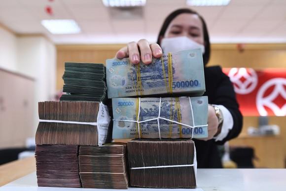 Kỳ vọng lợi nhuận khả quan năm 2021 sẽ là yếu tố giúp định giá cổ phiếu ngân hàng hấp dẫn. Ảnh: Hoàng Hà.