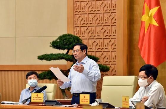 Thủ tướng Phạm Minh Chính chủ trì cuộc họp về phòng chống dịch Covid-19. Ảnh: VIẾT CHUNG