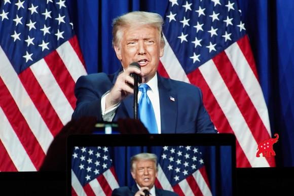 Màn hình hiển thị Tổng thống Hoa Kỳ Donald Trump phát biểu hôm thứ Hai 24/8 tại Hội nghị Quốc gia Đảng Cộng hòa năm 2020 ở Charlotte, Bắc Carolina. Ảnh: Xinhua