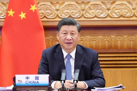Chủ tịch Trung Quốc Tập Cận Bình tham dự hội nghị thượng đỉnh G20 qua liên kết video ở Bắc Kinh hôm 21-11. Ảnh: Xinhua