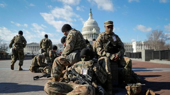 National Guard troops gather in front of the US Capitol ahead of president-elect Joe Biden's Inauguration in Washington © Mike Segar/Reuters