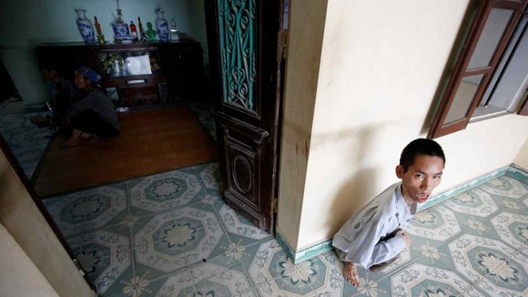 A 41-year-old man who was exposed to Agent Orange, pictured at his house in Bac Ninh province in August 2018: time is running out for Vietnamese victims.   © Reuters