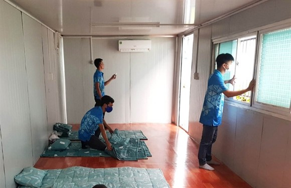 The Ocean Coatings (Vietnam) Company Limited, located in the Long Thành Industrial Zone, has set up six container offices to offer temporary accommodations for its workers. File photo from vnexpress.vn