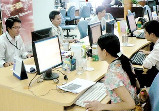 Chuyên viên phần mềm Việt Nam làm việc tại Công ty Global CyberSoft trong  Công viên Phần mềm Quang Trung. Ảnh: T.Ba