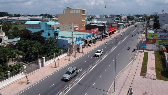 Đường Tô Ký, huyện Hóc Môn đã được nâng cấp, mở rộng. Ảnh: CAO THĂNG
