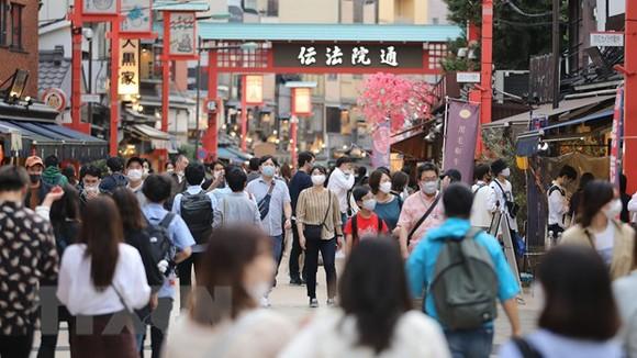Người dân tại thủ đô Tokyo của Nhật Bản. Ảnh: TTXVN