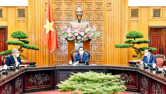 Thủ tướng Phạm Minh Chính tiếp Bộ trưởng Chính phủ Anh Alok Sharma. Ảnh: VIẾT CHUNG