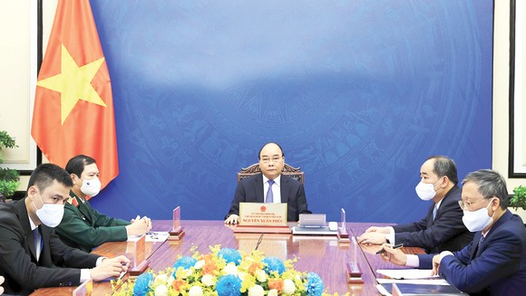 Chủ tịch nước Nguyễn Xuân Phúc điện đàm với Tổng Thư ký Liên hiệp quốc Antonio Guterres. Ảnh: TTXVN