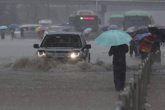 Trung Quốc nâng cảnh báo lũ lụt lên gần mức cao nhất ảnh 3
