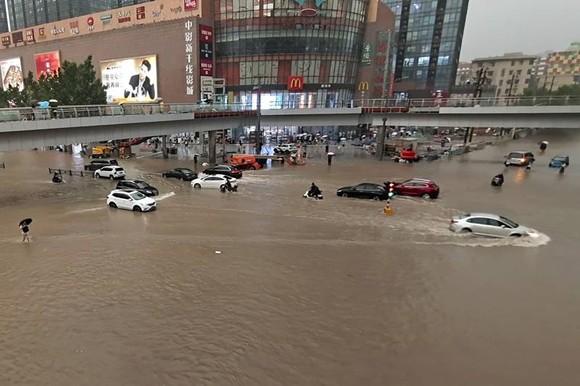 Trung Quốc nâng cảnh báo lũ lụt lên gần mức cao nhất ảnh 4