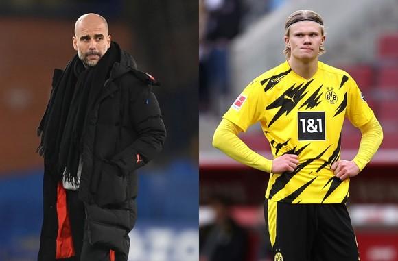 Pep Guardiola và Erling Haaland