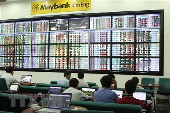 Giao dịch chứng khoán tại sàn Maybank KIM ENG (Thành phố Hồ Chí Minh). (Ảnh: Hoàng Hải/TTXVN)