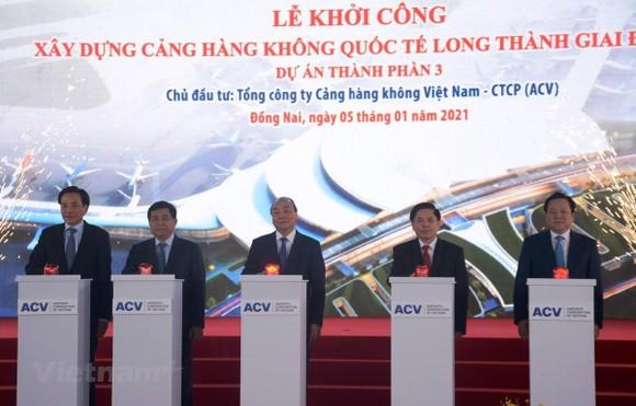 Thủ tướng Chính phủ Nguyễn Xuân Phúc nhấn nút khởi công dự án sân bay Long Thành. (Ảnh: Việt Hùng/Vietnam+)