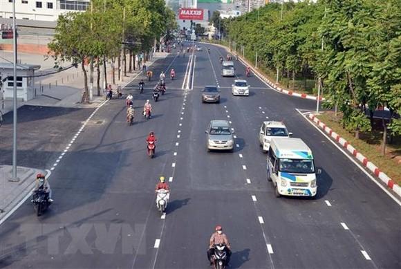 Đường Nguyễn Hữu Cảnh được nâng cấp, có khả năng giải quyết điểm ngập hơn 10 năm qua của Thành phố. (Ảnh: Tiến Lực/TTXVN)