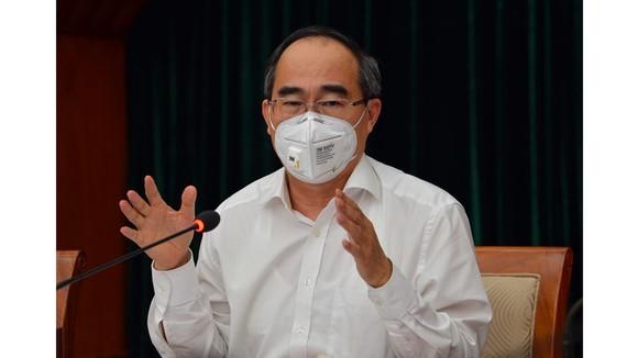 Bí thư Thành ủy TPHCM Nguyễn Thiện Nhân: Bớt thu nhập của cán bộ để hỗ trợ công nhân mất việc ảnh 3