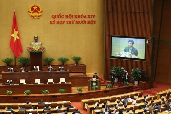 Cuối buổi sáng 25-3, Quốc hội nghe Tổng Thư ký Quốc hội Nguyễn Hạnh Phúc, Chánh Văn phòng Hội đồng bầu cử quốc gia trình bày báo cáo về công tác chuẩn bị bầu cử. Ảnh: QUANG PHÚC