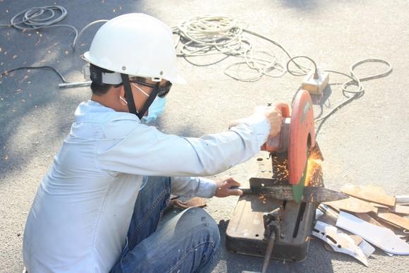 Công an quận Tân Bình tiêu hủy nhiều vũ khí thô sơ các loại ảnh 13