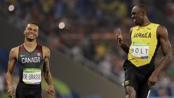 """""""Bại tướng của Usain Bolt"""" Andre de Grasse xưng hùng ở cự ly 200m, tuyển Mỹ bị loại ở cự ly tiếp sức 4x100m ảnh 2"""