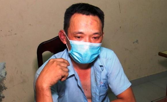Tài xế Nguyễn Văn Tuấn tại cơ quan công an