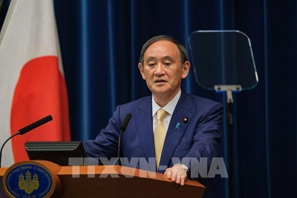 Thủ tướng Suga Yoshihide tại cuộc họp báo ở Tokyo, Nhật Bản. Ảnh: AFP/TTXVN