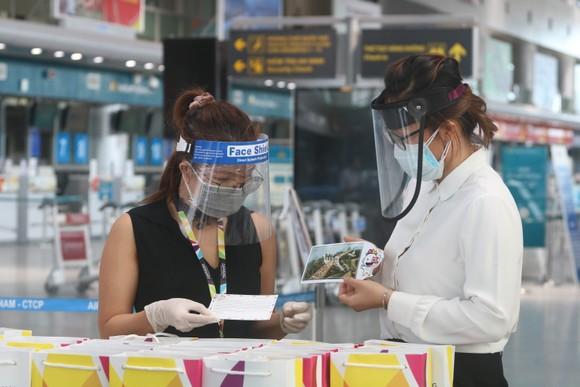 Đưa 207 du khách đầu tiên ở Đà Nẵng trở về địa phương bằng máy bay ảnh 5