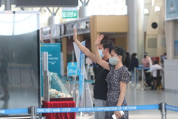 Đưa 207 du khách đầu tiên ở Đà Nẵng trở về địa phương bằng máy bay ảnh 9