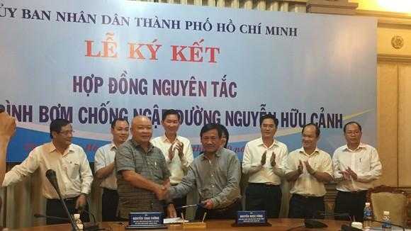 TPHCM thuê siêu máy bơm chống ngập cho đường Nguyễn Hữu Cảnh ảnh 1