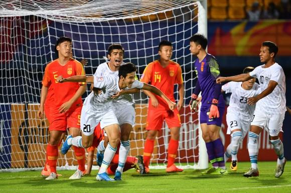 ĐKVĐ Uzbekistan trong trận thắng Trung Quốc ở vòng bảng.,Ảnh: AFC