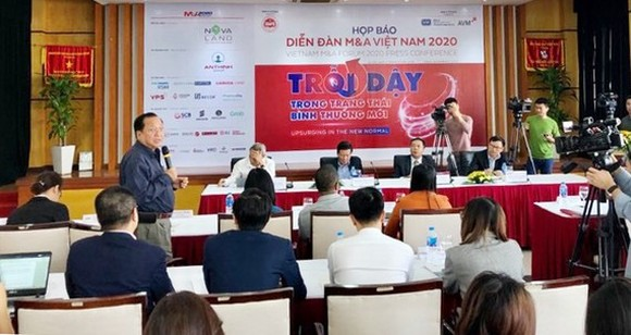 """The press conference on the Vietnam M&A Forum 2020 with the theme """"Rising in a new normal state"""". (Photo: SGGP)"""