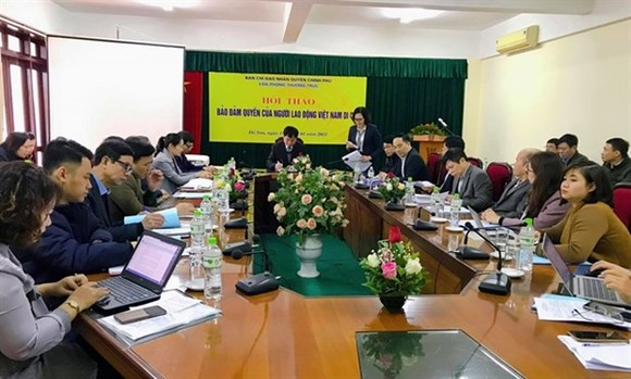 Delegates discuss problems and solutions to ensure better rights for Vietnamese guest workers abroad at a conference held on January 15 (Photo: VNA)