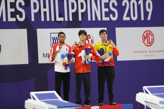 Anh Vien wins sixth gold medal at SEA Games 30 ảnh 1