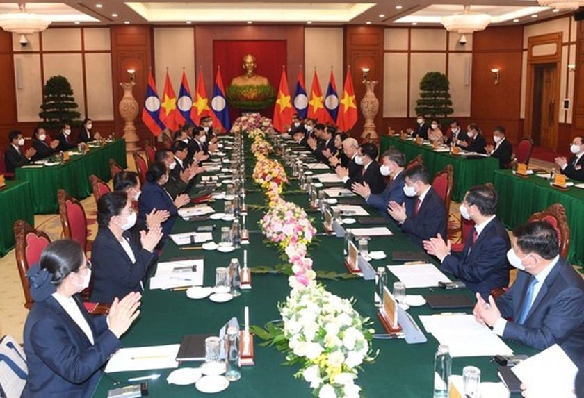 Party, State leader of Laos visits Vietnam ảnh 7