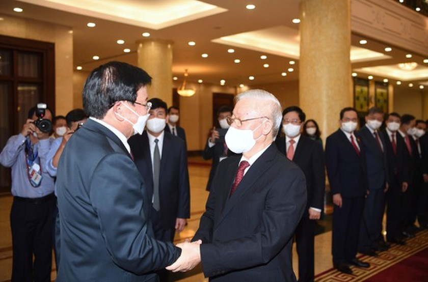 Party, State leader of Laos visits Vietnam ảnh 5