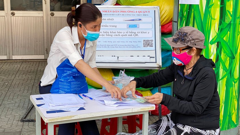 HCMC to finish disbursement of third financial support package before October ảnh 2