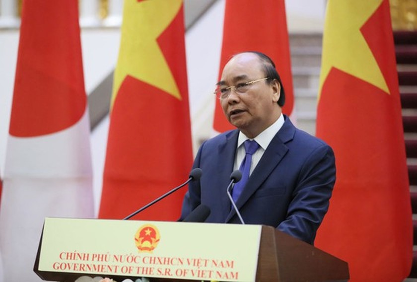 PM Nguyen Xuan Phuc chairs welcome ceremony for his Japanese counterpart ảnh 14
