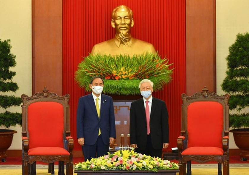 PM Nguyen Xuan Phuc chairs welcome ceremony for his Japanese counterpart ảnh 9